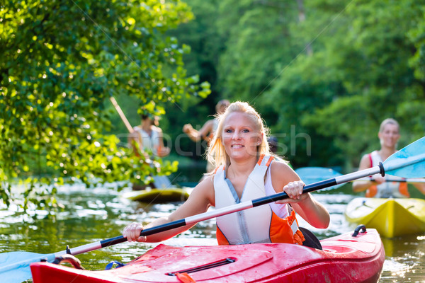 Friends driving with kayak on forest river Stock photo © Kzenon