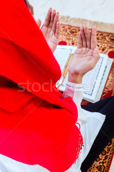 Asian Muslim woman praying with Koran Stock photo © Kzenon