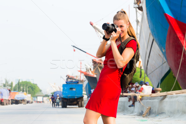 Jakarta Tourist with camera having harbor tour Stock photo © Kzenon