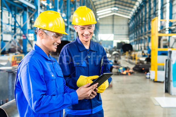 Stock photo: Two workers in production plant as team