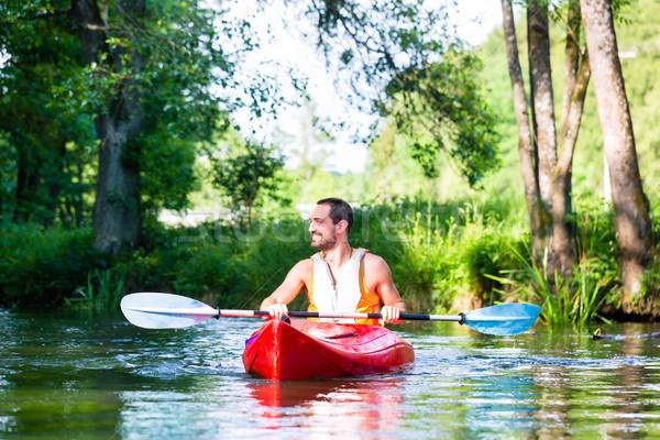 Férfi kenu kajak folyó erdő sport Stock fotó © Kzenon
