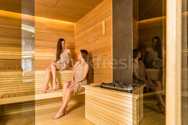 Stock photo: Two female best friends enjoying the therapeutic effect of a dry