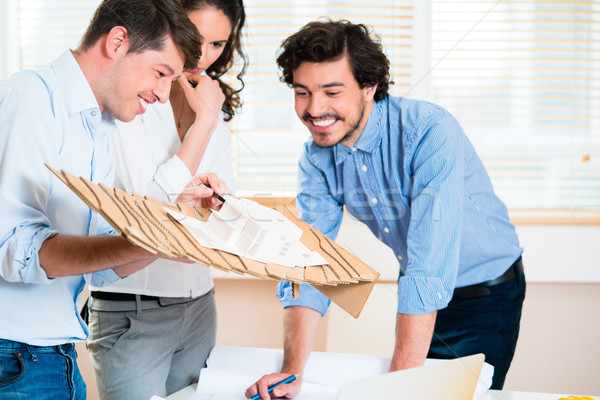 Architects present model of planned building Stock photo © Kzenon