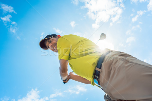 Low-angle view of a professional player holding the club during  Stock photo © Kzenon