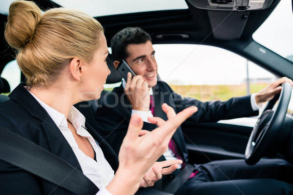 Woman in car being angry at phoning man Stock photo © Kzenon