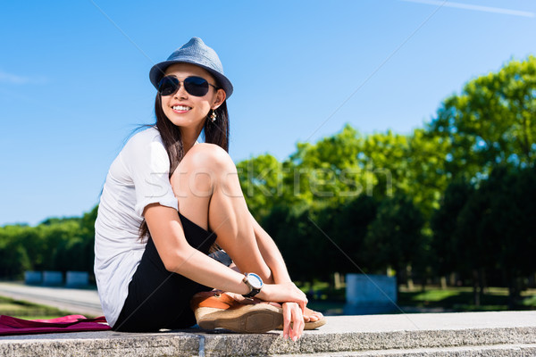 Young Asian woman smiling in the park Stock photo © Kzenon
