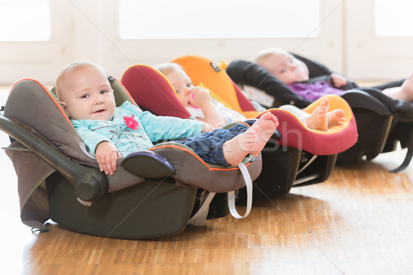 Stock photo: New-born babies in toddler group lying in baby shells