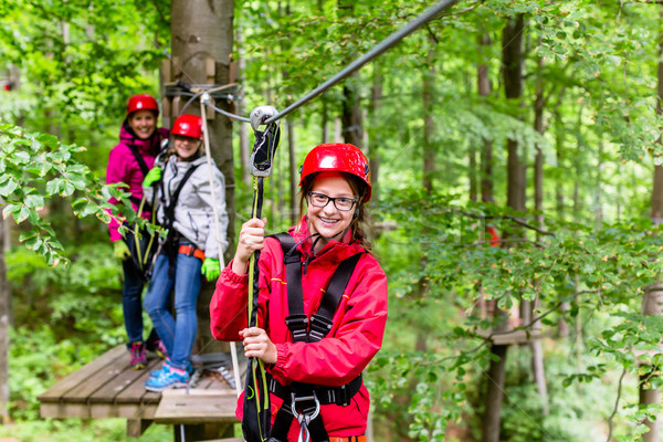 Family climbing in high rope course Stock photo © Kzenon