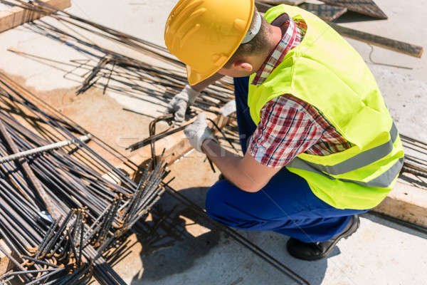 Reliable worker checking the quality of the steel bars Stock photo © Kzenon