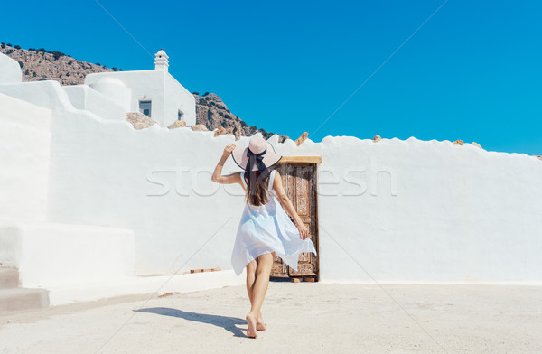 Woman approaching a greek house Stock photo © Kzenon