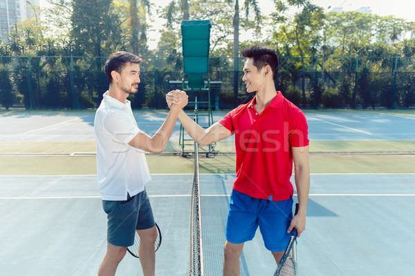 Deux professionnels tennis joueurs serrer la main geste Photo stock © Kzenon