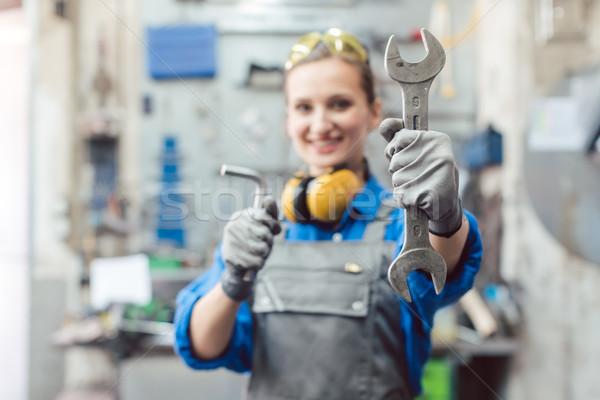 Woman mechanic showing tools to the camera Stock photo © Kzenon