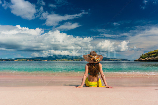 Young woman sitting on the sand at Pink Beach in Komodo Island Stock photo © Kzenon