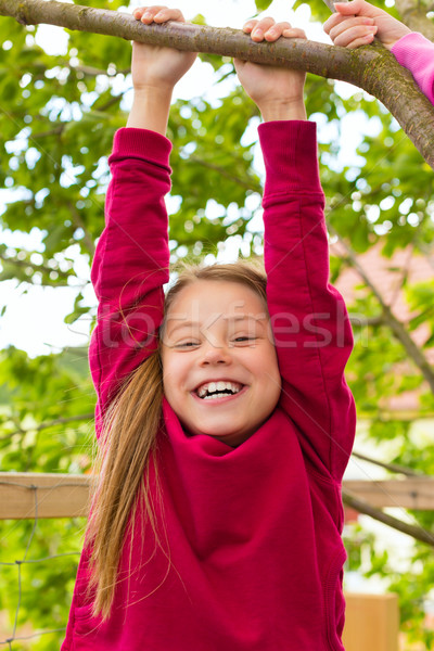 Happy child playing in the garden Stock photo © Kzenon