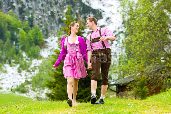 Happy couple hiking in Alpine meadow Stock photo © Kzenon