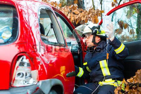 Accident - Fire brigade rescues Victim of a car crash Stock photo © Kzenon