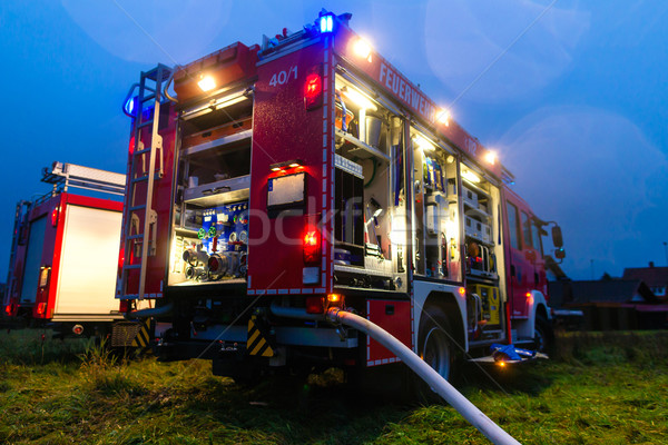 Fire truck with lights in deployment Stock photo © Kzenon