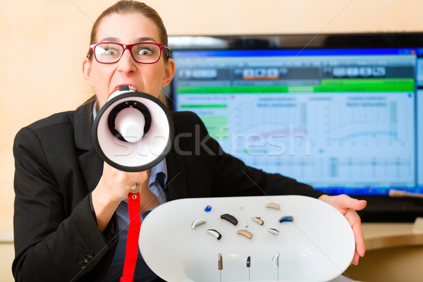 Woman advertising a hearing test Stock photo © Kzenon