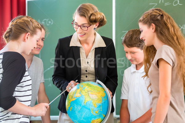 Teacher educate students  having geography lessons in school Stock photo © Kzenon