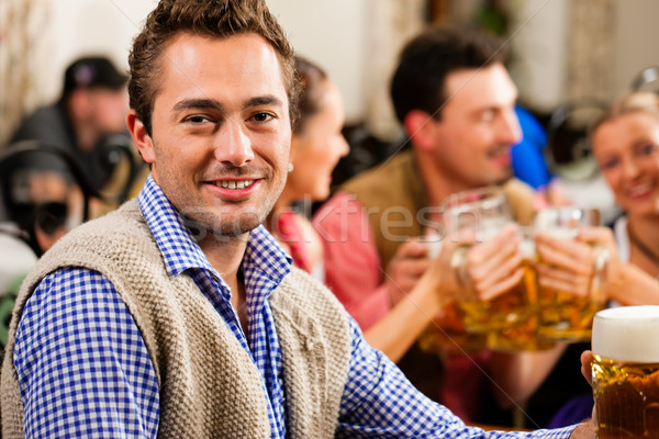 Man drinking beer in Bavarian pub Stock photo © Kzenon