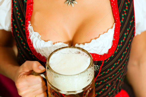 Woman with beer on d Stock photo © Kzenon