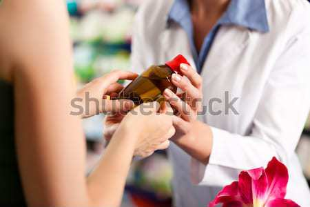 woman buying perfume in shop or store Stock photo © Kzenon