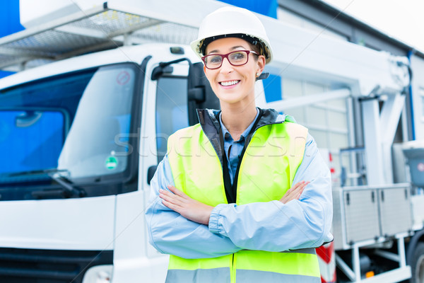 Female engineer in front of truck on site Stock photo © Kzenon