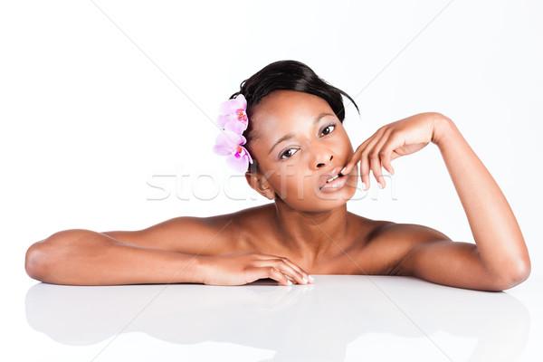 Beautiful African woman in Studio doing body care Stock photo © Kzenon