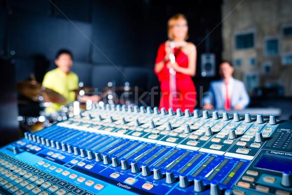 Asian professional band in recording studio mixing  Stock photo © Kzenon