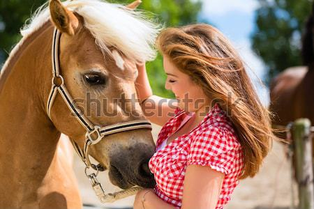 Couple petting horse on pony farm Stock photo © Kzenon