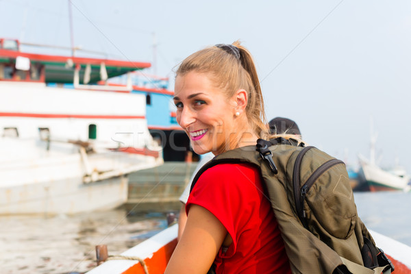 Stock photo: Jakarta Tourist at sightseeing on boat trip in harbour
