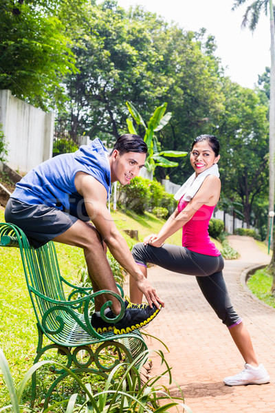 Woman and man exercising in park on bench Stock photo © Kzenon