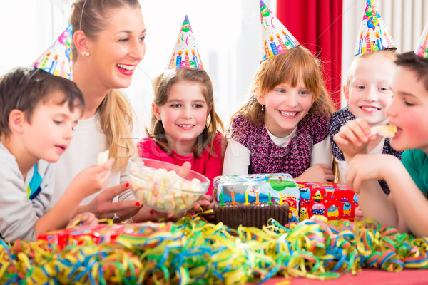 Children on birthday party nibbling candies Stock photo © Kzenon