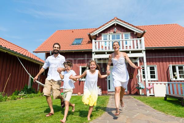 Family having fun with their new home or house Stock photo © Kzenon