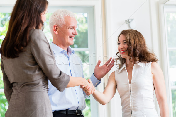Business people doing handshake after agreement Stock photo © Kzenon