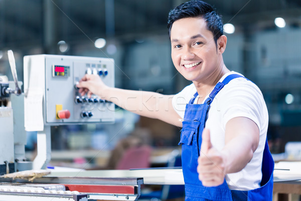 Worker showing thumbs up in Asian production plant Stock photo © Kzenon