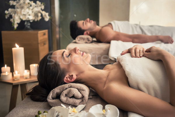 Man and woman lying down on massage beds at Asian wellness cente Stock photo © Kzenon