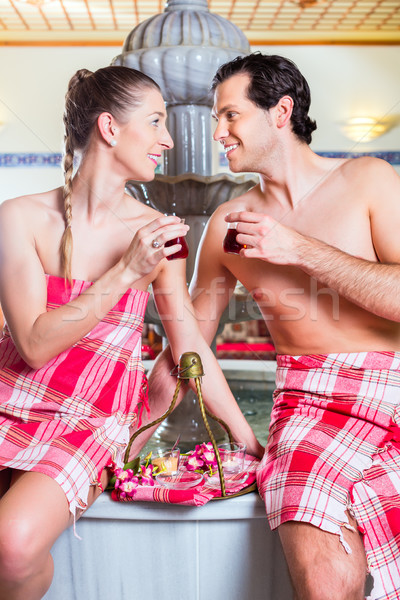 Couple drinking Turkish tea in wellness spa Stock photo © Kzenon