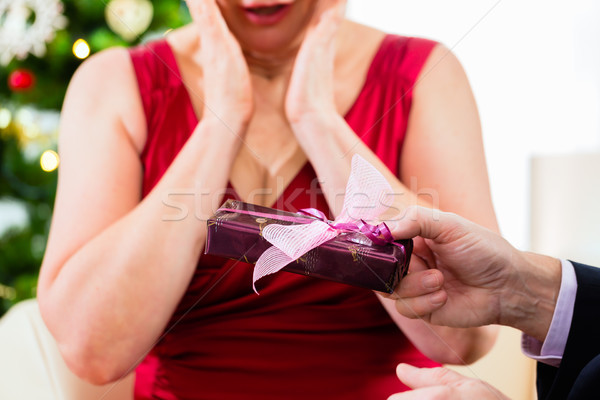 Senior couple celebrating Christmas eve with presents Stock photo © Kzenon