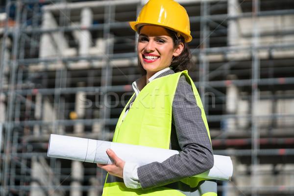 woman architect with construction plans at building site Stock photo © Kzenon