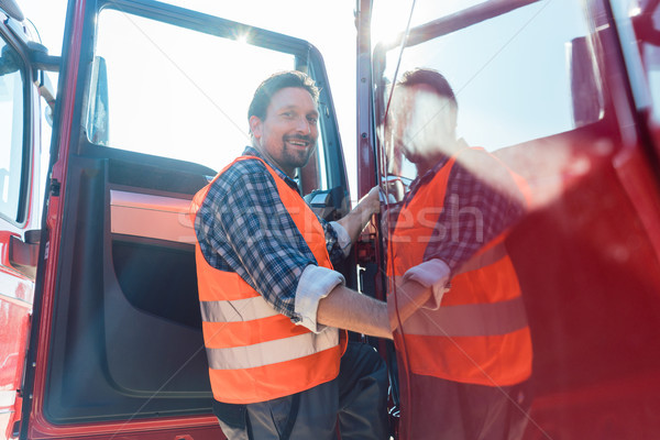 Truck driver in front of his long haul lorry Stock photo © Kzenon