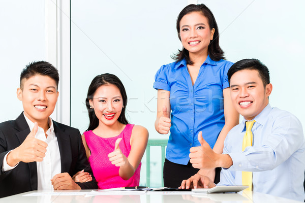 Asian Chinese financial consultants in office Stock photo © Kzenon