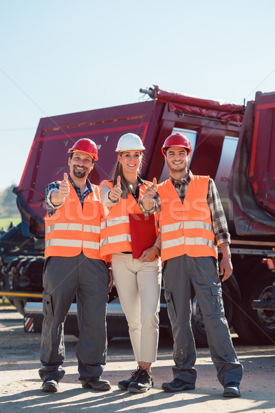 Colleagues in a freight forwarding company giving thumbs up Stock photo © Kzenon