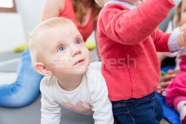 Portret cute blond spelen kleurrijk Stockfoto © Kzenon