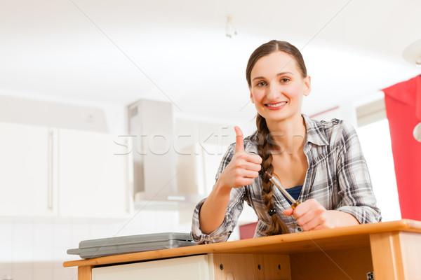 шкаф движущихся из женщину работу Сток-фото © Kzenon
