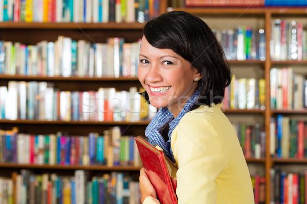 Asian girl at library holding a book Stock photo © Kzenon