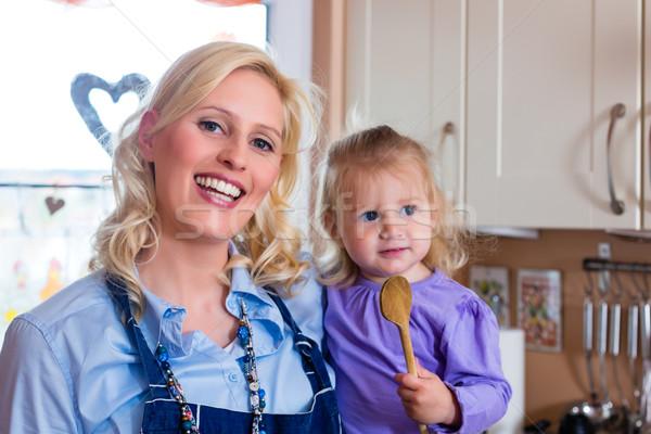 Family - mother and child baking pizza Stock photo © Kzenon