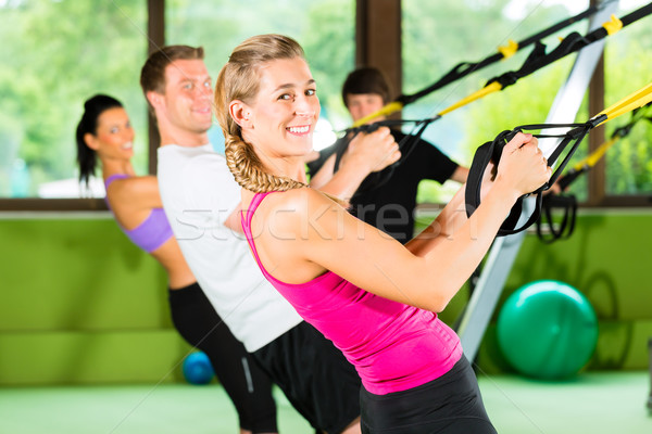 Fitness - Leute beim Suspension training Stock photo © Kzenon
