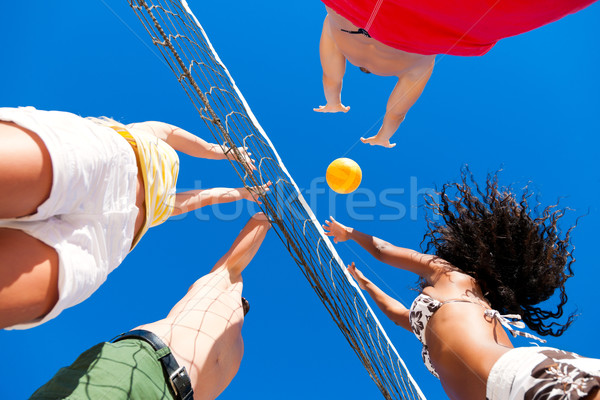 Barátok játszik tengerpart röplabda játékosok nyár Stock fotó © Kzenon
