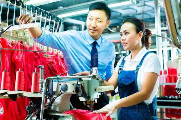 foreman in a factory explains something Stock photo © Kzenon